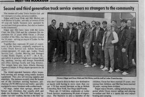 A faded newspaper clipping shows a group photo of 80's era Leduc Truck Service employees