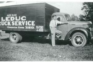 A decades-old photograph of young Alex Klak with his first delivery truck; Leduc Truck Service's fleet unit number 000001