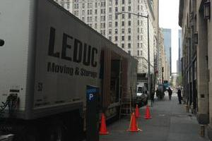 A bright Leduc Truck Service tractor-trailer unit on the streets of New York.