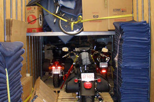 Motorsport bikes carefully protected during transport to their happy owners by Leduc truck Service
